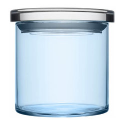"Iittala - Glass Jars 4.5"" x 4.25"" Light Blue - Looking at your storage situation through rose-tinted glasses? These jars are the solution! Line them up or stack them up on the kitchen counter for a clean display. A pretty vessel for vittles or a clean place for cotton swabs, these multipurpose containers fit anywhere you need smart, stylish storage."