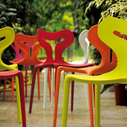 Area 51 Chair by Calligaris - The Area 51 Chair is one of the most versatile chairs you can find anywhere. It can be used inside or outdoors, rain or shine the Area 51 Chair will survive. Available colors are; White, Grey, Green, Orange, Red, and Pink.