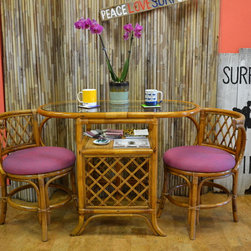 Furniture Reupholstery - The seats of a vintage rattan tea set is reupholstered in a Schumacher fabric by designer Alessandra Branca for the Ocean City, NJ upholstery shop.