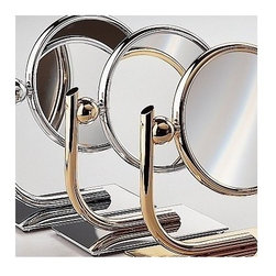 """Windisch by Nameeks - Stand Makeup Mirror - Windisch's Stand Mirrors makeup mirror is a optical mirror that will compliment a contemporary style personal bath. This free stand makeup magnifying mirror is a high-end option for your luxurious personal bathroom. This luxurious makeup magnifying mirror is made of the highest quality brass and finished in chrome, gold, or chrome and gold. Features: -Makeup mirror. -Stand Mirrors collection. -Contemporary style. -Round shape. -Free standing. -3x Magnification. -Double Face. Specifications: -Overall Dimensions: 9.45"""" H."""