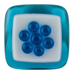 Vivien Hart - Spring Fever, Blue Knob - These fused glass knobs can add pizzazz to any room or special furniture piece. The knobs are lovingly handmade in my home studio. The object of these knobs is to bring art to a functional object that you can enjoy using every day. Each knob or pull is made using 2,3,4 or in some cases 5 layers of cut glass or glass powders. I often use clear glass either on top of or in between design layers to create a sense of depth. Several of my designs are also three-dimensional in nature. This requires them to be fired in multiple stages to create different effects. Some knobs are fired once while others are fired many times. The knob backing is made of a sturdy stainless steel and is hourglass shaped. The hardware does not cover the back completely thus allowing the glass knob to capture and reflect light. Matching pulls are available with some knob designs. Overall the knobs are consistent in size and color. However each piece is handmade so there may be slight variations between knobs.