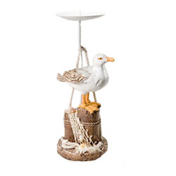 "Seagull on Pilings Candle Holder - The seagull on pilings candle holder measures 11.25H"" x 3.75"" x 4.25"". This item features a seagull standing on pilings that are wrapped in fisherman's rope and netting. It will add a definite nautical touch to wherever it is placed and is a must have for those who appreciate high quality nautical decor. It makes a great gift, impressive decoration and will be admired by all those who love the sea."