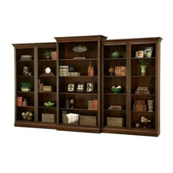 Howard Miller Oxford Bookcase - Saratoga Cherry - Make a grand statement with the Howard Miller Oxford Bookcase - Saratoga Cherry. With plenty of room for books and trinkets, this bookcase is a grandiose addition to you living room or study. Choose your configuration: center bookcase only, center and left return, center and right return, or center and both returns. No matter which you choose, you'll be enjoying a wonderful new bookcase in no time. The fluted front offers additional visual appeal. Durably constructed of hardwoods and veneers, then finished in a rich Saratoga Cherry stain.The Howard Miller Story Incomparable workmanship, unsurpassed quality, and a quest for perfection - these were the cornerstones of the company Howard C. Miller founded back in 1926, at the age of 21. Even then, Howard Miller understood the need to create products that would be steeped in quality and value. In 1989, Howard Miller began creating collectors' cabinets with the same attention to detail and craftsmanship inherent in their clock-making. Fashioned from glass and hardwoods, Howard Miller cabinets are ideal for displaying heirlooms, plates, glassware, and other collectibles. A highly respected brand, Howard Miller maintains its popularity because of the company's commitment to quality. Every product manufactured at the company's sprawling facility in Zeeland, Michigan, undergoes stringent tests and exceeds industry standards to ensure a lifetime of enjoyment.