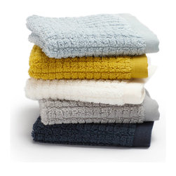 """Coyuchi Organic Cotton Sumptuous Wash Cloths - Simple luxuries. Our Sumptuous Wash Cloths go beyond good looks. At a generous 700 grams of organic cotton per square meter, the long, silky loops are woven into a reversible texture of jacquard on one side and grid on the other. Finished on either end with a band of dyed-to-match linen for a crisp feel. Available in five colors.  Care: All of our cotton & linen products are machine washable. We recommend using warm water and non-phosphate soap in the washing cycle, with a cool, tumble or line dry. The use of bleaching agents may diminish the brilliance and depth of the colors, so we recommend not using any whiteners.  Dimensions: 12""""L x 12""""W  Available colors: Mid Ocean, Pale Dusty Aqua, Pewter, Sunflower, White"""