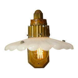 Antique Art Deco Sconce with Milk Glass Shade - This is a large Deco sconce that had a broken up shade when we found it. The sconce was probably an exterior building light and had been stored in a barn for years and years. We removed the broken shade and found a period appropriate glass shade that complements the large sconce beautifully. Finished off with Edison style bulb, cloth cord and vintage inline switch.