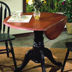 Sunset Trading - Eco-friendly Cafe Table in Antique Black and - Two 10 in. drop leafs. Solid handcrafted hardwood. Accommodates two to four people. Sturdy quality craftsmanship. Warranty: One year. Made from Malaysian oak. Made in Malaysia. Assembly required. 42 in. Dia. x 36 in. H (73.2 lbs.)Add classic charm to your home without compromising space or style.  Perfect for a small dining area or cozy nook, this Sunset Trading - Sunset Selections Collection double Drop Leaf Table serves your day-to-day needs yet transforms into the extra needed dining space when guests drop by. It may be small in size but it's large in versatility to meet your dining needs.