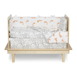 Argington Fish and Pebbles Print Organic Crib Bedding Collection - This modern crib bedding collection offers sophisticated and whimsical detail without overpowering the crib. Not to mention that the fabric is 100% organic cotton with organic cotton fill. With the addition of low-impact dyes, this soft and safe bedding is sure to please.