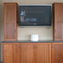 Outdoor Cabinets - Entertainment area with cabinets by Seifert Woodcrafts