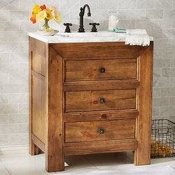 "Stella Single Sink Console, Weathered Pine finish - The natural whorls and fissures of pine give our Stella console its warm, mountain cabin appeal. Its thick, substantial silhouette is softened by the milky hues and crystalline veins of Carrara marble. 30"" wide x 22"" deep x 36"" high Expertly crafted with a solid hardwood frame. Top is made of 1 inch-thick Carrara marble, known around the world for its exceptional quality and natural beauty. Console is fitted with a white ceramic sink (included). Features two spacious drawers. Use with any of our faucet collections (sold separately). Professional installation required. View our {{link path='pages/popups/fb-bath.html' class='popup' width='480' height='300'}}Furniture Brochure{{/link}}."