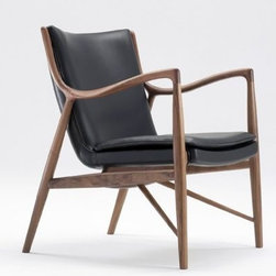 "Finn Juhl - Model 45 Chair - Shortly before Finn Juhl became a world-renowned name, he was a self-taught furniture designer and trained architect who had just opened his own office. Working in collaboration with master cabinetmaker Niels Vodder, the pair was the buzz of the 1945 Cabinetmakers' Guild exhibition with their expressive, sculptural pieces. One such item was the Model 45 Armchair (1945), which broke from tradition by freeing the upholstered areas from the wood frame. With the Model 45, Juhl refined the type of easy chair that he had been working on for many years; creating the type of elegant, tantalizing expression for which this designer is still without rival. This original is an authentic, fully licensed product of Onecollection, House of Finn Juhl™. Made in Denmark. Finn Juhl made his U.S. debut in 1951, at the ""Good Design"" exhibit in Chicago and at MoMA in New York. When Juhl was 39, he was the architect appointed to represent Denmark in creating the interior of a meeting hall at the United Nations headquarters in New York."