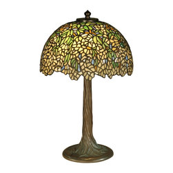 Dale Tiffany - Dale Tiffany TT10335 Wisteria Tiffany Table Lamp - Lush Wisteria flowers are a splendid representation of springtime in this delightful table lamp. Featuring over 1200 pieces of hand rolled art glass in luxurious shades of green, yellow and pink, this piece is as beautiful as nature intended the Wisteria to be. The tree trunk base, crafted in a beautiful antique bronze verdigris finish, enhances the natural beauty of the Wisteria flower.