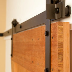 """Real Sliding Hardware - Prop Barn Door Hardware Kit (Modern Style) - Real Sliding Hardware's """"Prop"""" style barn door hardware looks great in contemporary homes. Exposed wheels glide on a steel rail for the ultimate barn door look. Great for interior doors where space is limited. Available in unfinished steel or a variety of durable powder-coated finishes including black, oil-rubbed bronze, and more. Kit includes everything needed to hang one door. For biparting doors, simply choose the appropriate kit size for each door and order quantity two."""