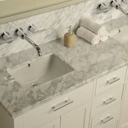 J & J International Double Sink Vanities - J & J International Direct Bath Furniture manufactures beautiful, high-quality and affordable Double Sink Vanities including vanity cabinets and vanity sets, bathroom accessories and custom furniture. J & J International provide luxurious double vanity sink and single vanity cabinets to both consumers and building professionals at greatly reduced prices. J & J International design, manufacture and distribute a line of exclusive bathroom furniture products that are equal to, and in many cases better than, the quality of the brand-name competition, but available at considerably lower cost to you. J & J International innovate and emerge mature product lines and makes designer level product lines accessible to everyday customers. While the majority of our current product line is in bathroom Vanities Furniture, our business plan includes expansion into other high-quality, affordable furniture products.
