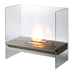Frontgate - Igloo Bioethanol Fireplace - The Igloo Bioethanol Fireplace is designed with a futuristic appeal to enhance any contemporary decor. Distinctive and original, it features a toughened glass surrounding that conveys a disappearing effect. A stainless steel bench is suspended between the glass, allowing the flame to dance in many directions off the reflective panels. This unique fireplace generates ambiance and warmth and ensuring a stunning centerpiece. Constructed of stainless steel and toughened glass . Runs on bioethanol, a renewable energy . Heat output of 13,000 BTUs . Heats up to 377 sq. ft. . Burn time of 9-20 hours . Suitable for indoor use . Includes BK5 burner, jerry can, lighter with lighting rod . EPA certified .