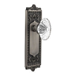 Nostalgic - Double Dummy-Egg & Dart Plate-Oval Fluted Crystal Knob-Antique Pewter - With its distinctive repeating border detail, as well as floral crown and foot, the Egg & Dart Plate in antique pewter resonates grand style and is the ideal choice for larger doors. Combined with our Oval Fluted Crystal Knob (24 individual hand-ground facets!), the look is elegant, but never fussy. All Nostalgic Warehouse knobs are mounted on a solid (not plated) forged brass base for durability and beauty.