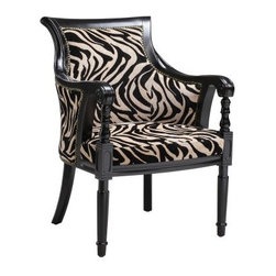 Stein World Zebra Barrel Chair - The Stein World Zebra Barrel Chair is more elegant than a barrel of monkeys. Which isn't necessarily difficult so let's just say this is an inimitable arm chair that will bring your home years of comfort. The spacious back and seat offer sublime relaxation and the chair's ornate design vibrant zebra-print upholstery and fine detailing bring a sublime aesthetic balance. About Stein WorldStein World is dedicated to discovering and bringing to the market place the finest hand-painted products from around the world. With over 50 years of experience they have been able to develop not only the resources but true partnerships with quality manufacturers and artisans who make Stein World unique in the furniture industry today. Their commitment to you is to present only the highest quality furniture at prices that bring future family heirlooms into everyone's price range.