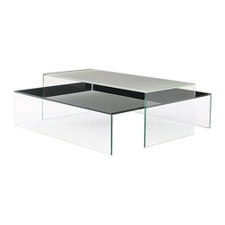 Bensen - Pool Coffee Table - Niels Bendtsen's Pool Table Collection (2004) is a juxtaposition of undisturbed flat water (like a table) and man-made squares and rectangles (like a pool). Highlighting these shapes are the green edges of the thick glass and reflections in the frosted or black tabletops. Pool's tempered glass top and sides are permanently fused at mitered corners using a UV gluing process that offers rigid strength and a clean connection. Exposed edges are polished flat, making them smooth to the touch. The top's color is silk-screened on the bottom of the panel and then baked to give a flawless and permanent hue. A variety of sizes offer several nesting possibilities, easily arranged to fit individual needs. Made in China.