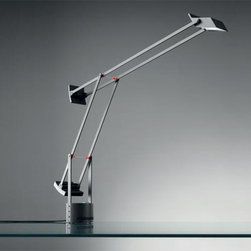 Artemide - Tizio Classic LED Table Lamp | Artemide - Design by Richard Sapper, 2009.The Tizio Classic LED Table Lamp is adjustable to provide direct, task LED lighting. Composed of a fully adjustable, balanced, electrical conductor arms with counter weights and a translucent polycarbonate shield. Features an adjustable die-cast aluminum head whit an inner high efficiency reflector. The bases is 360° rotatable with an incorporated low voltage transformer and dimmer. LED is tested in accordance with IES LM-79-08.  UL Listed.