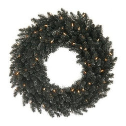 Vickerman Black Fir Pre-Lit Wreath - Clear Lights - The Vickerman Black fir Pre-Lit Wreath - Clear Lights is perfect for holiday decorating. The wreath has a traditional shape and style with faux fir branch tips, but the black color sets it apart from the rest. Hang it for Halloween, then add black and white or silver ornaments for a stunning modern Christmas wreath. The wreath hangs anywhere. Decorate your office or home with this exciting wreath.About VickermanThis product is proudly made by Vickerman, a leader in high quality holiday decor. Founded in 1940, the Vickerman Company has established itself as an innovative company dedicated to exceeding the expectations of their customers. With a wide variety of remarkably realistic looking foliage, greenery and beautiful trees, Vickerman is a name you can trust for helping you create beloved holiday memories year after year.