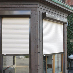 Shutters on Glass Walled Room - Talius Rollshutters providing security and optional privacy to a room with glass walls.