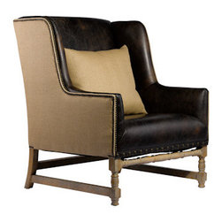 Curations Limited - Antwerpen Leather Wing Arm Chair - The Curations Limited leather wing chair features soft glove leather and Belgium-style hemp.  The scale of this wing chair renders it suitable in the living room, the bedroom, and everywhere besides.  The solid weathered ash hardwood frame is hand-carved and supports a seat with 8-way hand-tied spring suspension.    The coordinating back cushion is composed of poly fiber with a contrasting down pillow.  Hand-hammered brass studs compliment the angles of the frame and accentuate its unique shape.