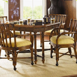 Tommy Bahama Home - Samba Game Table Set - Includes one game table and four game chairs. Warranty: 1 year limited. Made from maple veneers, selected hardwood solids. Plantation - Lightly distressed warm umber finishGame Table:. Cracked coco shell top. Four felt-lined drawers, one each side. Drawer construction using English dovetails. Wood runner and guides. Drawer stop. Tommy Bahama drawer plaque. Custom designed hardware with an antique brass finish. Woven cane edging. Decorative metal stretcher. Eight legs. 42 in. L x 42 in. W x 30 in. H (132 lbs.)Game Chairs:. With arms and casters. Bent rattan fame. Leather binding on arms and frame. Standard fabric upholstered. 26 in. W x 23.75 in. D x 34 in. H (30 lbs.). Special Care InstructionsIsland Estate lends inspiration to tropical design through a rich blending of natural materials, textures and exciting new finish colors. Designs for the whole home encompass an eclectic mix of British Plantation and refined Caribbean styling, with a playful dose of exotic island fun. Wherever the locale, Island Estate embodies lifestyle that is elegant and refined, yet casual and cool. The essence of Tommy Bahama Home is a relaxed approach to the fine things in life.