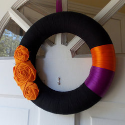 Halloween Wreath by Belle Rose Designs - Greet guests with a simple but bold wreath adorned with fabric flowers.