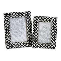 "IMAX - Lizzie Bone Frames - Set of 2 - A set ofeetwo photo frames made with bone inlay make the perfect desk, shelf or vanity accessory. White bone inlay with black cross pattern gives these frames a simple decorative appeal. For a coordinated look, display with the Lizzie bone inlay boxes.  Item Dimensions: (8.5-9.5""h x 6.5-7.5""w x 6.5-7.5"")"