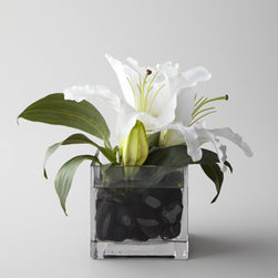 "John-Richard Collection - John-Richard Collection ""Evening White"" Faux Floral - Exclusively ours. Add a dash of natural beauty to any space with this petite faux floral arrangement featuring white Casablanca lilies with black rocks in a clear glass vase. From the John-Richard Collection. Handcrafted of polyester silk, glass, a..."