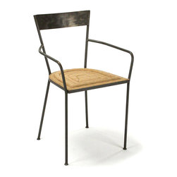 Kathy Kuo Home - Klaas Industrial Modern Raw Steel Burlap Seat Dining Arm Chair - No industrial dining table is complete without a suitable seating option, and that's where the Klaas Arm Chair comes in.  This dining chair is supported by a dark antique charcoal powder-coated steel frame and features an iron and washed burlap construction.  Foam and fiber fill the seat in a rolled pattern, offering comfort that is sure to be appreciated during any meal.  A modern chair for the design-conscious, it is a fantastic addition to the industrial loft or dining room.