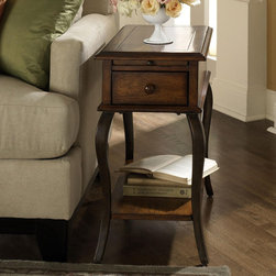 """Riverside Furniture - Serena End Table - The classic look of our Serena occasional table collection brings style and creativity to spaces both small and large. The metal base in Brazen bronze has the traditional style of centuries old furnishings and supports a glass top in a wood frame, whose Brown Sugar finish brings warmth and balance to the look. Features: -Decorative metal motif suspended under top.-Supported by gracefully arched resin legs.-One pull out tray with stop is located between top panel and drawer.-One small storage drawer mounted on a wood guide with stop.-Base levelers in bottom of legs.-Constructed of a rubberwood hardwood framed top with a wooden insert.-Brown Sugar finish.-Serena collection.-Collection: Serena.-Distressed: No.Dimensions: -Overall Product Weight: 34 lbs.-Overall Height - Top to Bottom: 26"""".-Overall Width - Side to Side: 14.75"""".-Overall Depth - Front to Back: 24.75""""."""