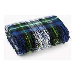 Faribault Woolen Mill Co. - Stewart Plaid Wool Throw, Blue Plaid - Faribault Woolen Mill was the first company to introduce a stadium blanket with the introduction of the Pak-A-Robe in 1949. These rugged throws are designed to be used outdoors and are naturally soil repellent. Dirt and debris can simply be brushed away returning the throw to like-new condition. Faribault pioneered the use of machines to create the distinctive rolled fringe used on this blanket. We use the same machine today to create the fringe on these throws. Permanently moth-proofed.