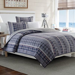 Nautica - Nautica Tiller Reversible Quilt - The Tiller quilt is a classic Nautica plaid in gorgeous navy, blue and denim color ways all combined in vertical stripes. This bedroom-friendly quilt is infused with fun colors and comfortable, soft hand that everyone can dive into.