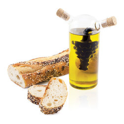 Grape Oil & Vinegar Cruet - Add a sophisticated note to your pantry or kitchen table with this Grape Oil and Vinegar Cruet. With cork stoppers at the spouts and a grape motif, the 2-in-1 cruet makes a perfect gift for oenophiles and at-home gourmands alike.
