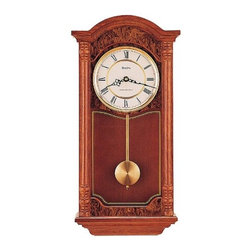 """Bulova - Edenhall Pendulum Wall Clock - Made solid oak with a dark oak finish, this classic wall clock is sure to highlight any home or office. With burl finish accents and recessed glass side panels, the Edenhall Wall Clock has a striking appearance. Choose from Westminster or Whittington melody movement with night shut-off option and adjustable volume control. Features: - Dark oak finish. - Solid oak case . - Burl finish accents. - Recessed glass side panels. - Dual-chime German movement plays Westminster or Whittington chimes on the quarter hour. - Adjustable volume control with night shut-off option. - Roman numerals. Specifications: - Recommended battery type: C. - 1-Year warranty. - Overall Dimensions: 23"""" H x 11.75"""" W x 4.75"""" D."""