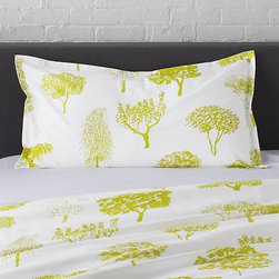 "Marimekko Rantapuisto Citron King Sham - Global forest plants citron silhouettes of the world's trees on crisp white cotton percale bedding, artfully rendered in designer Fujiwo Ishimoto's painted design. Inspired by his observations of nature in many settings, the pattern is named Rantapuisto, a Finnish word meaning ""beach park."" Sham has a 1"" flange and generous overlapping back closure. Bed pillows available."