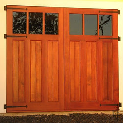 Evergreen's Olympic 3 lite carriage door - I like the mix of planked panels with the glass and heavy hinges for a classic, arts and crafts style.