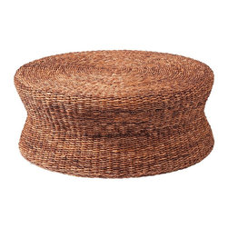 Lanai Woven Round Coffee Table Ottoman - Organic simplicity. Handwoven with twisted banana leaf. This sophisticated piece echoes the peace and calm of a seaside escape. The truly natural look adds incredible depth and texture to your room and creates a neutral color palette perfect for building a room around.