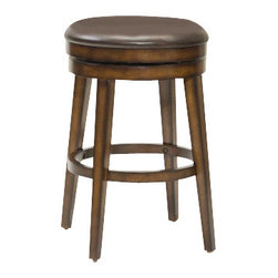 Hillsdale Furniture - Hillsdale Beechland Backless Swivel 30.5 Inch Barstool - Sometimes the simple and traditional ways are best and that is evident in Hillsdale Furniture's Beechland swivel stool. A backless swivel stool with sturdy tapered legs and an ample brown vinyl seat this stool is taken from plain to posh by it's unique rustic oak finish. The warm tones and burnished edges add that extra wow to a stool that is a great fit for any bar area or kitchen. Constructed of sturdy hardwood with veneer.