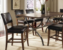 Hillsdale Cameron 7 Piece Counter Height Rectangle Wood Dining Table Set with Pa - A perfect blend of traditional and modern styles the Hillsdale Cameron 7 pc. Counter Height Rectangle Wood Dining Table Set with Parson Chairs features a traditional trestle table design given a modern update. Its wood top is finished in beautiful chestnut brown while the metal base is finished in dark gray. Each parson counter chair has a sturdy wood construction with chestnut brown finish and is upholstered in dark brown faux leather with decorative nail head trim. About Hillsdale FurnitureLocated in Louisville Ky. Hillsdale Furniture is a leader in top-quality affordable bedroom furniture. Since 1994 Hillsdale has combined the talents of nationally recognized designers and globally accredited factories to bring you furniture styling and design from around the globe. Hillsdale combines the best in finishes materials and designs to bring both beauty and value with every piece. The combination of top-quality metal wood stone and leather has given Hillsdale the reputation for leading-edge styling and concepts.