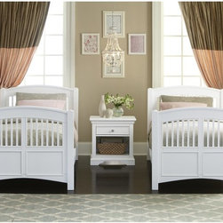 NE Kids - Walnut Street Hayden Spindle Twin Bed - White - FUB549 - Shop for Beds from Hayneedle.com! The Hayden Spindle Bed White offers more than just a stylish sleeping surface. Its sturdy poplar frame is fully-slatted and mattress-ready and an optional trundle or two spacious pull-out drawers and a small open storage area are offered with the piece. The headboard and footboard of the piece features a charming slatted design that pairs well with the brilliant white finish. select veneers and brushed nickel solid iron ring pulls round out the design.About New Energy Kids NE Kids is a company with a mission: to create and import truly unique furniture for your child. For over thirty years they've been accomplishing this mission with flying colors one room at a time. Not only will these products look fabulous they will provide perfect safety for your children by adhering to the highest standards set by the American Society for Testing and Material and the Consumer Products Safety Commission. Your kids are in the best of hands and everyone will appreciate these high-quality one-of-a-kind pieces for years to come.