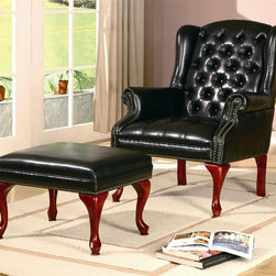 Coaster - Accent Wing Back Button Tufted Chair w Ottoma - Traditional style. Black faux leather upholstery. Elegant rolled arm with classic nail head trim. Rectangular ottoman. Cherry finish high cabriole wood legs. Chair: 31 in. W x 32.5 in. D x 41 in. H. Ottoman: 24 in. L x 16 in. W x 17 in. H. WarrantyCreate a sophisticated traditional style in your living room or family room with this elegant chair and ottoman combo. The matching ottoman offers a cozy spot to rest your feet, perfect for sitting back and relaxing while reading a book or watching TV. This chair and ottoman are sure to complement your home decor.