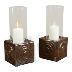 Interlude - Josef Hurricanes - Light up your favorite dining space with this lovely set of ceramic and glass hurricanes. A swirl design adds touchable texture to the chocolate brown cube shaped holder, while a clear glass cylinder protects your candlelight from any breezes.