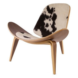 Wegner Shell Chair Cowhide - Among Hans Wegner's most famous designs, this three-legged accent chair almost fell into obscurity. After a limited series in 1963, a re-launch in 1997 introduced it to a new generation. Crafted from American walnut veneer on bent plywood,  it has a padded seat and back covered in random black, brown and white cowide.