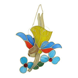 Zeckos - Stained Glass Fairy In Flight  Wall Plaque with Flowers - This cheerful stained glass wall plaque features a fairy in flight tending to her flowers. It measures 11 inches tall, 9 inches wide, 1 inch deep and is crafted from beautiful pieces of colored glass. Display alone or in a group, on the wall or as suncatchers. NOTE: Suction cups are not included.