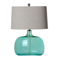 Mariana Lighting - Mariana Lighting Sea Glass Table Lamp - Sweet, simple, coastal style brings fresh color to your room from this lovely accent lamp. Set it on your side table or other surface and watch it flourish, from its aqua seeded glass base to the textured linen shade. The transparent nature of the base is enhanced from the light bubbly texture of the glass for a charming table lamp with serene, unassuming South Beach style. Dark nickel-colored hardware brings the light fixture's design together, complimenting the natural-toned linen lampshade.Lamp base made with seeded aqua-colored glassNatural-toned textured linen lampshade includedFits one (1) light bulb (not included)Plugin table lamp