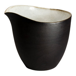 Black and White Milk Tumbler - The clean lines of this beautiful earthenware milk tumbler are elegant and simple.  Each is slip-cast by hand in black clay and the outside is left unglazed, offering a unique tactile and visual contrast between the matte exterior and the light glossy white interior.  Fired at stoneware temperature, they are food-safe, dishwasher and microwave safe. The nature of the clay and Diana's technique make each item distinctly unique, giving each a personality of it's own.  Handmade in South Africa.