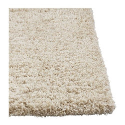 Zia Natural Shag Rug - Shag is back, with a look and feel like never before—even in the round. A modern mix of natural and synthetic yarns in soft natural with a glint of shiny gold, hand-tufted for a super soft, feel-good texture.
