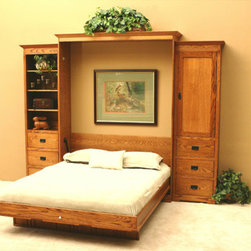Wallbeds - Mission Oak Murphy Bed - The beam structure mattress tray provides foundation-like support and is operated with a patented piston lift system with a ten-year limited warranty. The bed latches closed and features a key lock for added security. Installation is done with household tools in less than an hour. Features: -Material: Oak solids and quarter-sawn veneers.-Side cabinets not included.-All exposed edges banded with solid hardwood for protection.-Beam structure mattress platforms for foundation-like support.-Patented lift mechanism for ease of operation.-Bed latches in the closed position for security.-Keyed lock allows bed to be locked closed to prevent unwanted operation.-Buckled straps hold mattress in place under your linens, not interfering with making the bed.-Accepts standard size mattresses up to 11'' thick.-Made in USA.-Mission Oak collection.-Distressed: No.-Collection: Mission Oak.-Country of Manufacture: United States.Dimensions: -Dimensions: 90'' H x 68'' W x 22'' D.-Overall Product Weight: 315 lbs.Warranty: -10 Year limited warranty.