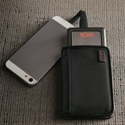 """Tumi - Mobile Power Pack - TumiMobile Power PackDetailsIncludes the power pack USB/USB micro power cable and protective ballistic carrying case.Approximately 3.125""""W x 0.75""""D x 4.875""""T.Imported.Designer About Tumi:Started in 1975 and now a leading international brand of travel business and lifestyle accessories Tumi is dedicated to providing customers with an outstanding ownership experience. During the 1980s Tumi introduced soft ultra-functional black-on-black ballistic nylon travel bags. Today Tumi holds more than 25 patents for its design and engineering breakthroughs."""